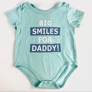"""Big smiles for daddy"" onesie"